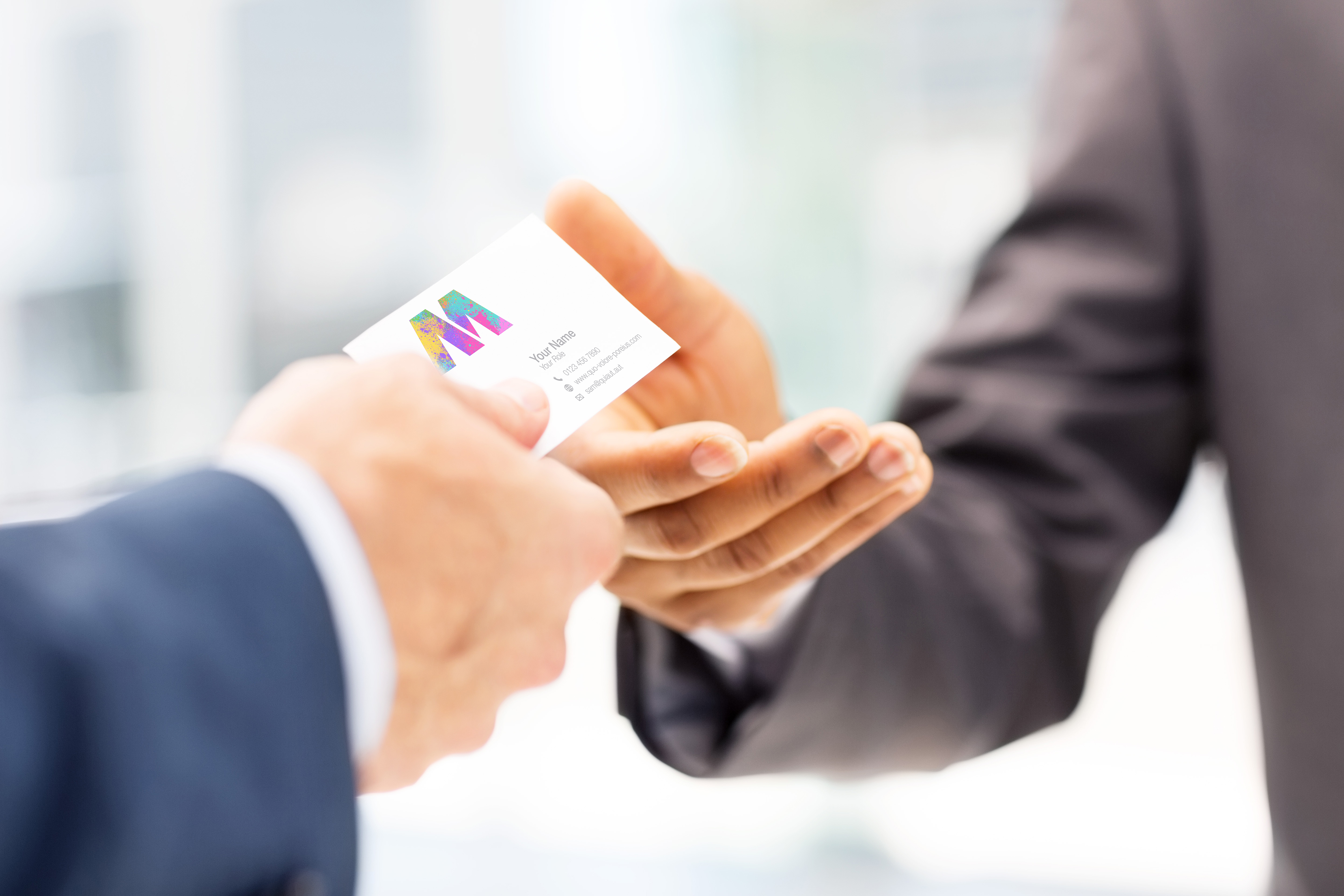 Man handing a custom printed business card in full color to another man