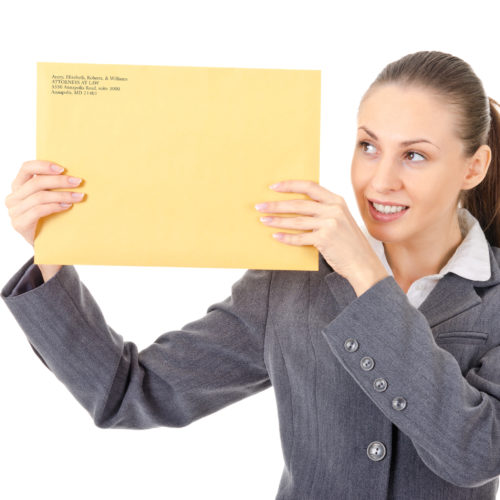 Woman holds a custom printed large brown envelope with corporate branding