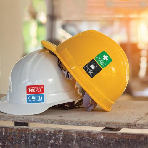 Custom labels on construction hard hats